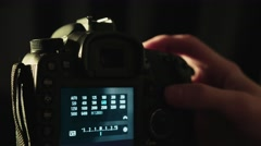 Camera Operator Changing ISO & White Balance Settings on a DSLR - stock footage