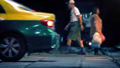 Busy Main Road With People Passing At Night - stock footage