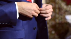The man unbuttoned button on his blue jacket Stock Footage