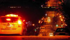 Cars On Hill In City With Subway Passing At Night Stock Footage