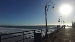 Ocean sparkles and moves from beyond the boardwalk Stock Footage