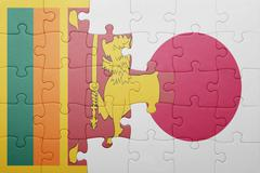 Puzzle with the national flag of sri lanka and japan Stock Photos