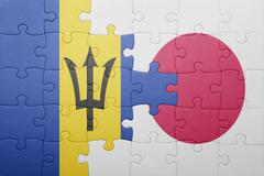Puzzle with the national flag of barbados and japan Stock Photos