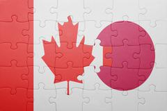 Puzzle with the national flag of canada and japan Stock Photos