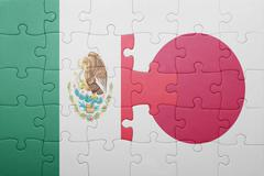 Puzzle with the national flag of mexico and japan Stock Photos