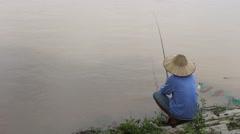 Fishing areas, men sit riverside fishing Stock Footage