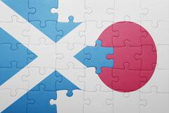 puzzle with the national flag of scotland and japan - stock photo
