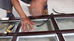 workers are doing door, aluminum door glass sector - stock footage