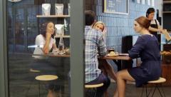Collaboration meeting in coffee shop - stock footage
