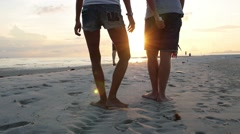 Couple of Lovers Making Foot Prints on Beach at Sunset Stock Footage