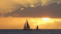Sunset in ocean yacht sailing - stock footage