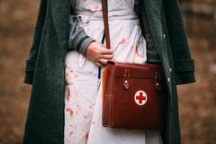 Unidentified re-enactor wears historical German Red Cross - DRK - stock photo