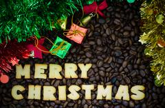 """Alphabet """"merry christmas"""" made from bread cookies on coffee beans background Stock Photos"""