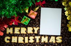"""Latte art coffee and alphabet """"merry christmas"""" made from bread cookies Stock Photos"""