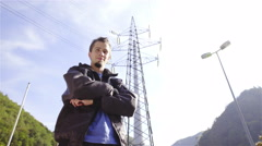Male person look over shoulder at electric tower 4K Stock Footage