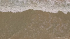 Aerial pov of beach wave from above slow motion Stock Footage