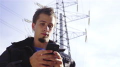 Man making notes under electric tower 4K Stock Footage