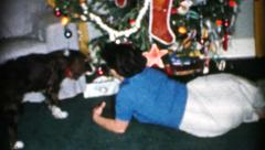 Mother And Son Plus Puppy Preparing Christmas Gifts-1956 Vintage 8mm film Stock Footage