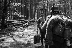 Unidentified re-enactors dressed as World War II German soldiers - stock photo