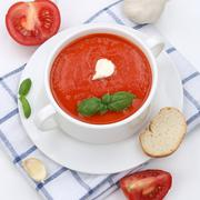 Healthy eating tomato soup with tomatoes and baguette in cup - stock photo