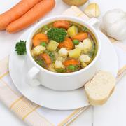 Healthy eating vegetable soup meal with vegetables and baguette Stock Photos