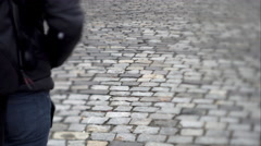 Man goes forward on a stone slab Stock Footage
