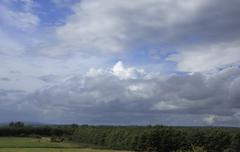Beautiful blue sky with storm clouds over countryside in Ireland Stock Photos