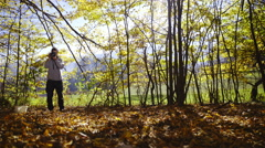 Photographer take picture in autumn forest 4K  Stock Footage