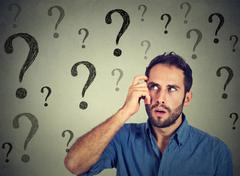 Thoughtful confused handsome man has too many questions and no answer Stock Photos