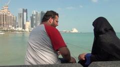 Veiled muslim women fishing at Corniche Stock Footage