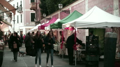 People observe the Christmas market in Sestri Levante - stock footage