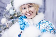 Portrait of a beautiful woman snow maiden close up in winter clothes Stock Photos
