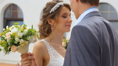 Beautiful young couple stand on the balcony Stock Footage