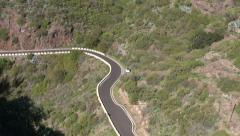 Serpentine road with a white car, near Masca, Tenerife, Spain Stock Footage