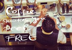 Barista and coffee machines at the bar, message Coffee makes you feel free wi Stock Photos