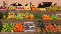 Sunlit fruits in the market stall Stock Footage