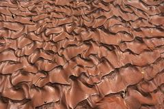 Patterns in sand after heavy thunderstorm Arches National Park Moab Utah USA - stock photo