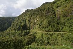 Death road winding through the subtropical rainforest Camino de la Muerte - stock photo