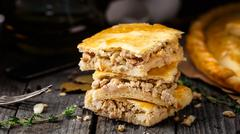Homemade pie stuffed with chicken ang eggs - stock photo