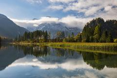 Almsee in autumn with clouds Totes Gebirge Almtal Upper Austria Austria Europe - stock photo