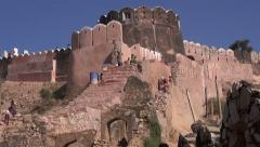 Workers in Jaipur red city  Nahargarh fort in Rajasthan, India Stock Footage