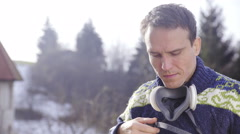 Man put on Respirator portrait shot 4K Stock Footage