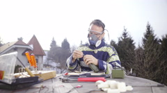 Man with Respirator mask prepare the hand drill 4K - stock footage