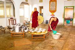 BAGO, MYANMAR -November 26, 2015: Monks preparing lunch in the monastery at B - stock photo