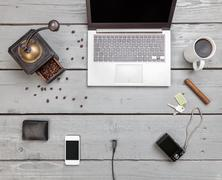 Workspace on a wooden table from above Stock Photos