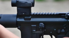 Young girl shooting ak-47 at range rifle pan shoot showing brand new beryl Stock Footage
