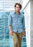 Male fashion model posing outdoors - stock photo