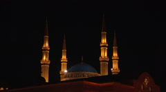 Zoom out Al-Amin mosque by night Stock Footage