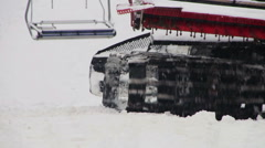 Snowcat works on a mountain slope at the ski resort Stock Footage