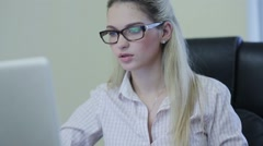 Beautiful businesslady working on laptop Stock Footage